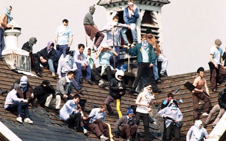 """Programme Name: Strangeways - Britain's Toughest Prison Riot - TX: 01/04/2015 - Episode: Strangeways - Britain's Toughest Prison Riot (No. n/a) - Picture Shows: April 1990. Riot at Strangeways prison, Manchester - """"prisoners on the prison roof"""" - (C) Rex - Photographer: Unknown"""